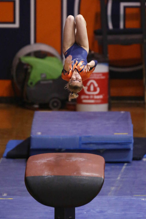 Illinois Amber See preforms her Vault routine during the meet against Ohio State and Central Michigan at Huff Hall, on Sunday, Feb. 23. The Illini recorded a score of 196.775.
