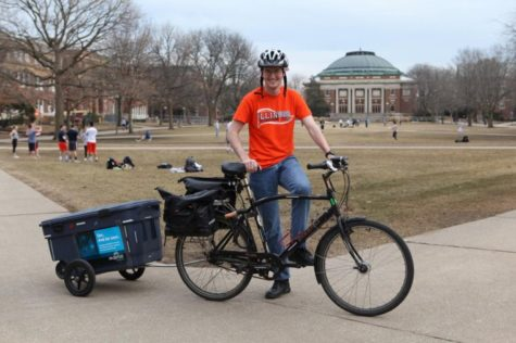 Jared Bowman is one of many volunteer bike trailers who will transport e-waste from participating buildings to collection sites to minimize traffic during the collection event from 2 to 6 p.m. on Tuesday.
