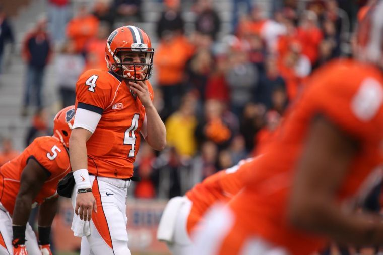 Illinois' Reilly O'Toole looks to the bench during the game against No. 3 Ohio State at Memorial Stadium in Champaign, Ill., on Saturday, Nov. 16, 2013. The Illini lost 60-35.