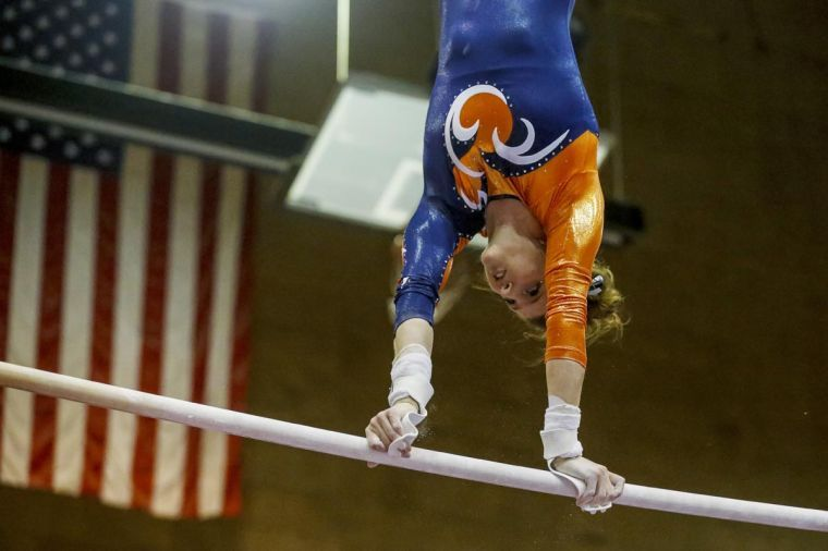 Illinois%27+Mary+Jane+Horth+competes+her+uneven+parallel+bars+routine+during+the+Gym+Jam+at+Huff+Hall+on+Saturday%2C+March+8%2C+2014.