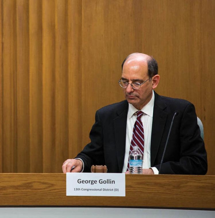 George Gollin speaks at a public forum held for candidates for Congressional representation of the 13th district of Illinois on Friday, Feb. 20 at Champaign City Council Chambers.