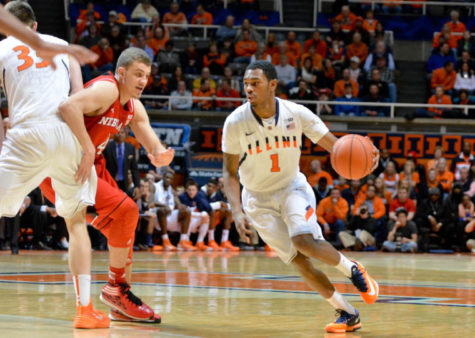 Illinois' Jaylon Tate (01) dribbles around a defender against Nebraska at State Farm Center on Wednesday, Feb. 26, 2013. The Illini won 60-49.
