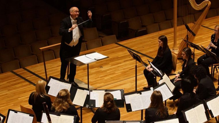 J. Ashley Jarrell, the University's first doctoral candidate in Wind Conducting and visiting assistant director of bands, conducts a concert at Foellinger Great Hall on Thursday, Feb. 20, 2014.