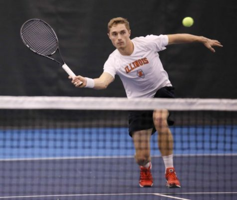 Illinois Tim Kopinski attempts to return the ball during the meet against Pepperdine, at Atkins Tennis Center, on Mar. 14, 2014. The Illini won 5-0.