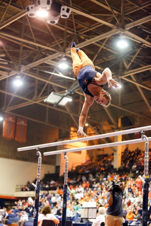 Illinois' Cameron Rogers preforms his parallel bars routine during the meet against UIC at Huff Hall, on Saturday, Mar. 9.