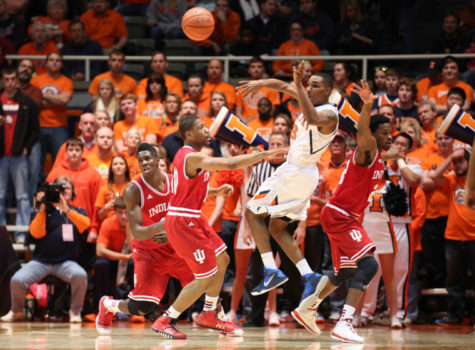 Illinois' Tracy Abrams (13) passes after driving to the baseline during the game against Indiana at State Farm Center, on Tuesday, Dec. 31, 2013. The Illini won 83-80.
