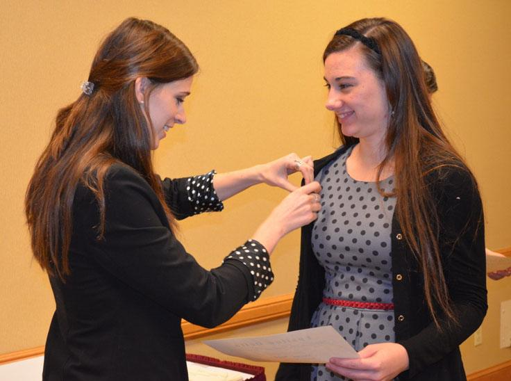 Epsilon+Delta+president+Louise+Mathews+and+member+Melissa+Boyce+partake+in+the+sorority%27s+Fall+2013+Initiation+Pinning+Ceremony%2C+on+Dec.+8%2C+2013.