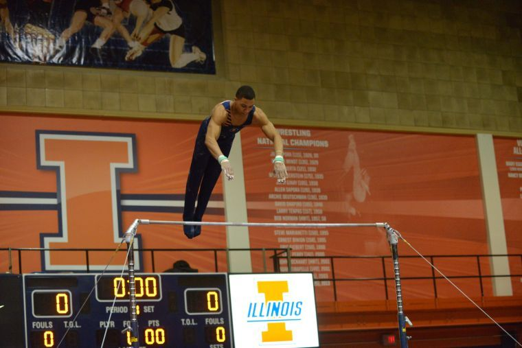 Illini Chandler Eggleston performs the high bar routine against Ohio State at Huff Hall on Jan. 26.