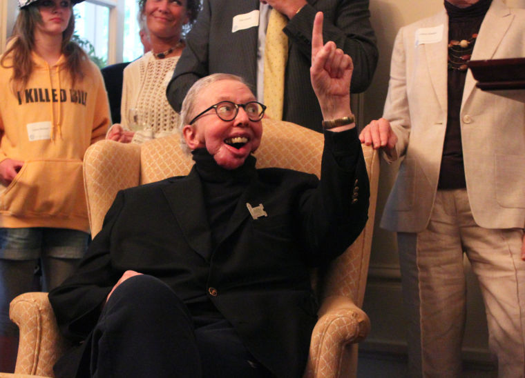 Roger Ebert raises his hand to interject during his wife Chaz Hammelsmith Ebert's (not pictured) speech at the Ebertfest Opening Night Gala at the President's House on Wednesday, April 25, 2012.