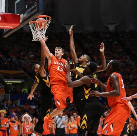 Illinois' Jon Ekey rises for a layup against Iowa at State Farm Center, on Feb. 1. Ekey hit a buzzer-beater to beat the Hawkeyes on Saturday.
