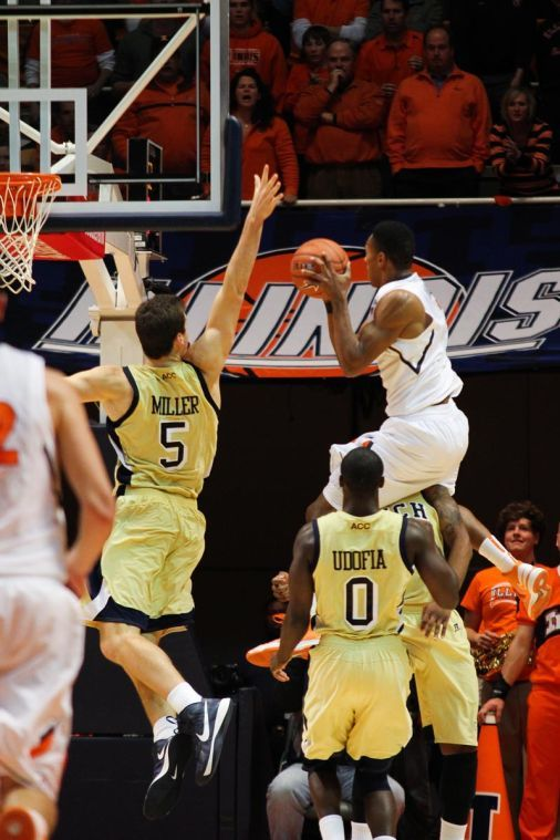 Illinois Joseph Bertrand jumps over his opponent for the layup during the Fighting Illini's win over Georgia Tech at State Farm Center, on Nov. 28, 2012.