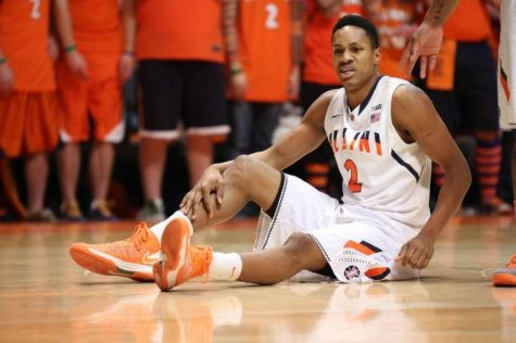 Illinois' Joseph Bertrand (2) holds an injured leg during the game against No. 12 Michigan, at State Farm Center, on Tuesday, March 4. The Illini lost 84-53.