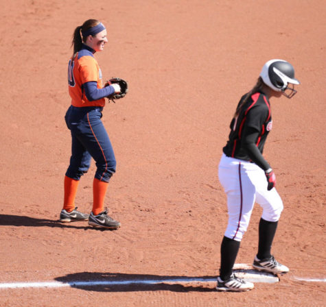 Illinois' Katie Repole (10) watches over third base during the match against Omaha at Eichelberger Field, on Saturday, Mar. 15, 2014. The Illni won 6-1.