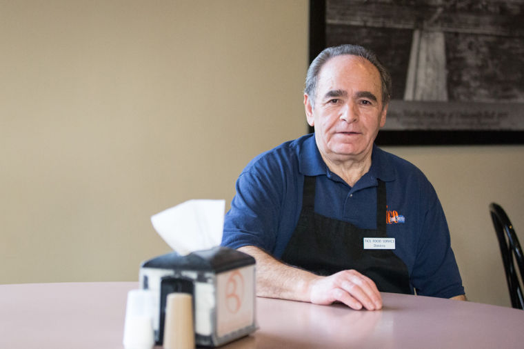Dimitris Yfantis works at Bromley dining hall on March 11.