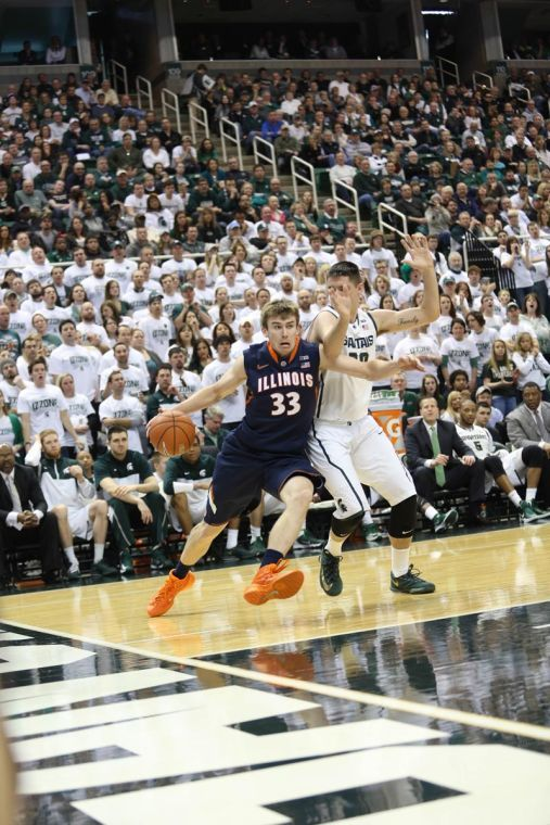 Illinois' Jon Ekey drives to the hoop during the game against Michigan State at the Breslin Student Events Center on Saturday.