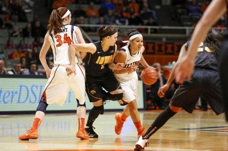 Illinois' Amber Moore (42) drives the ball during the game against Iowa at State Farm Center on Sunday, March 2, 2014.