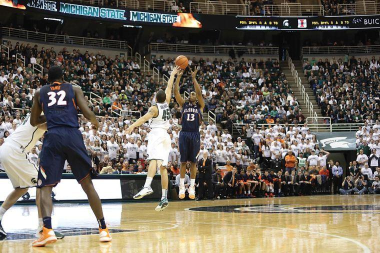 Illinois' Tracy Abrams(13) shoots a three pointer during the game against Michigan State University at the Breslin Student Events Center on Mar. 1, 2014.