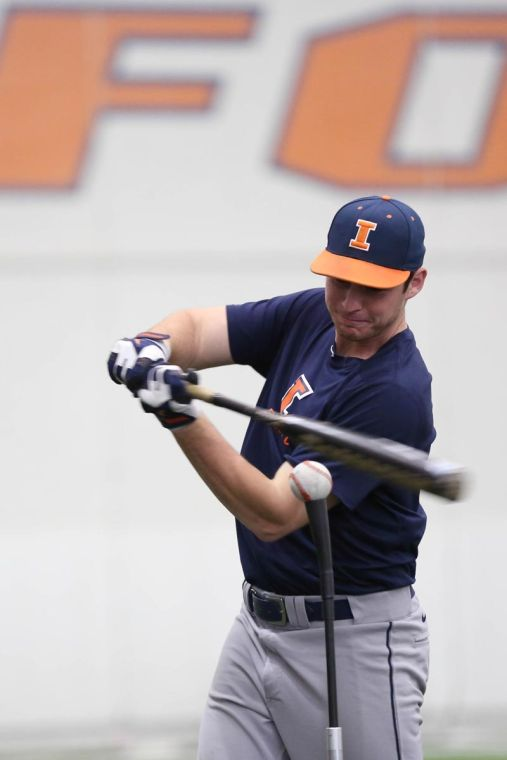 Fighting+Illini+baseball+player+Ryan+Nagle+warms+up+on+the+tee+during+practice.