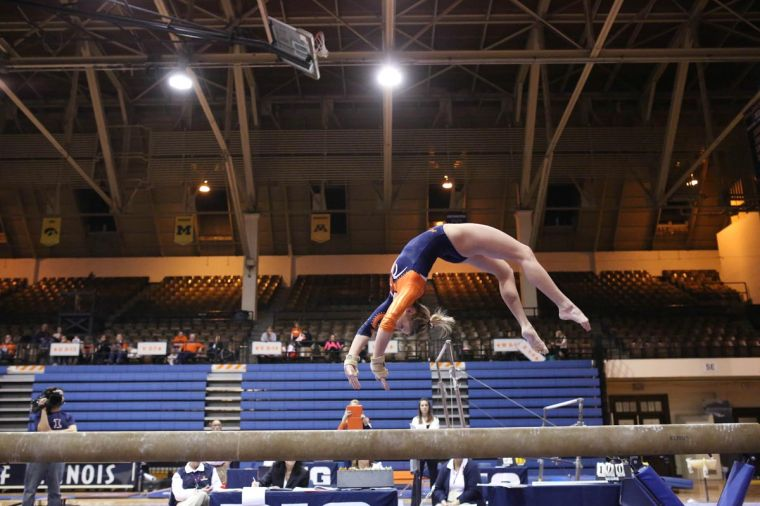 Illinois' Amber See preforms on the balance beam during the meet against Michigan, at Huff Hall, on Friday, Feb.7, 2014 The Illini lost 195.800-195.575