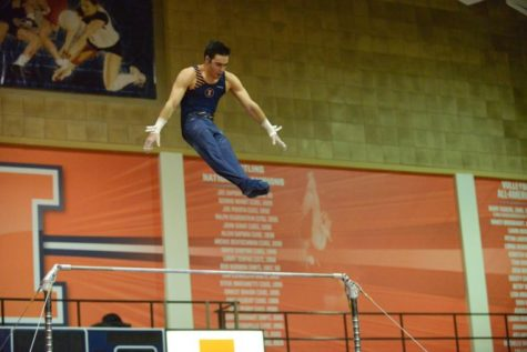 Jordan Valdez performs a high bar routine against Ohio State at Huff Hall on Jan. 26.