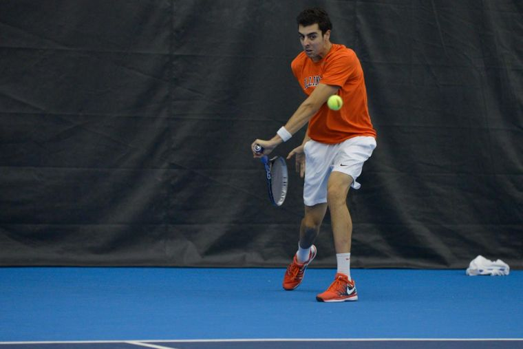 Illinois' Farris Gosea hits the ball during the match against No. 8 Texas at Atkins Tennis Center on Sunday, Feb. 9, 2014. The Illini won 4-3.