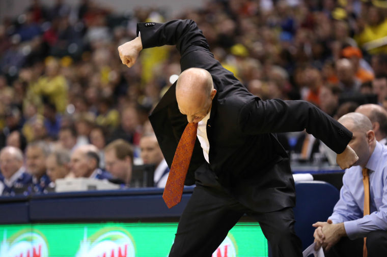 Illinois' head coach John Groce reacts to an Illinois turnover during the quarter-final game of the Big Ten Men's Basketball Tournament against Michigan at Banker's Life Fieldhouse, on Friday, Mar. 14, 2014 The Illini lost 64-63.