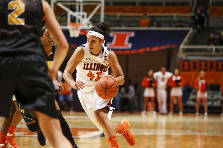 Illinois' Amber Moore drives the ball during the game against Iowa at State Farm Center on Sunday, March 2.