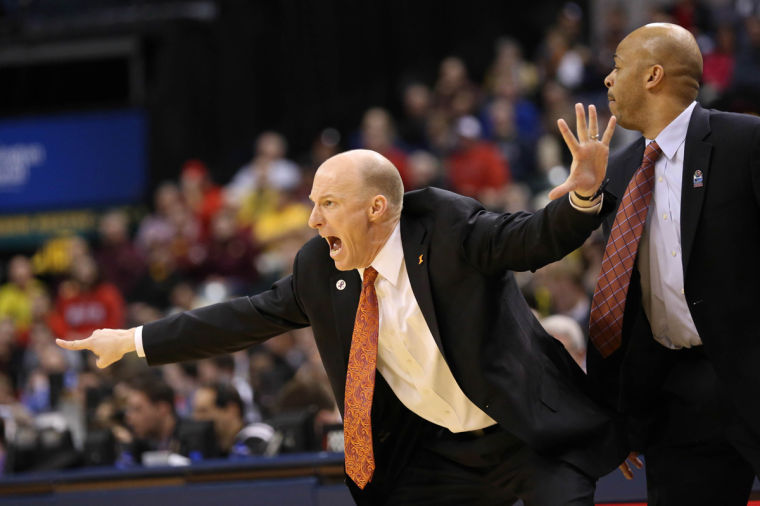 Illinois' head coach John Groce instructs his team during the quarter-final game of the Big Ten Men's Basketball Tournament against Michigan at Banker's Life Fieldhouse, on Friday, Mar. 14, 2014 The Illini lost 64-63.