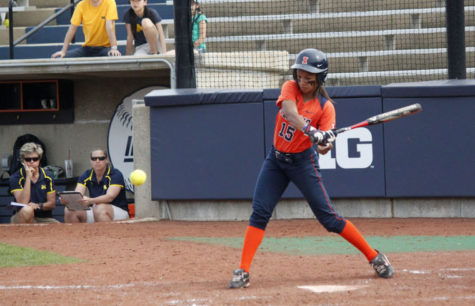 Illinois' Alex Booker attempts to hit the ball during the second game against Michigan on Saturday. The Illini lost 6-5.