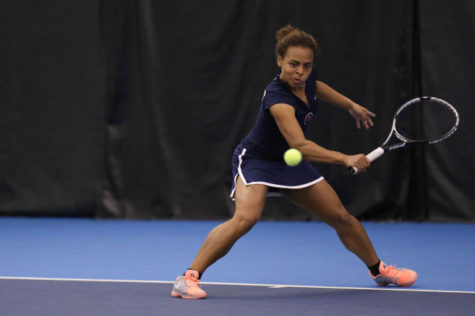 Illinois' Jerricka Boone attempts to return the ball during the meet against Nebraska, at Atkins Tennis Center, on April 13, 2014. The Illini won 4-2.