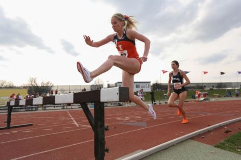 Illinois' Britten Petrey runs the 3000-meter Steeplechase during the Illinois Twilight Track and Field meet at Illinois Soccer and Track Stadium on Saturday, April 12.