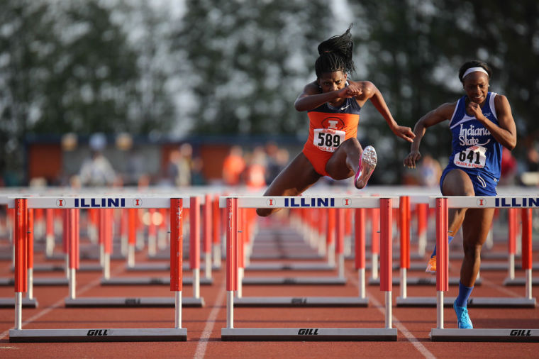 Illinois' Jesica Ejesieme runs the 100 meter hurdles event during the Illinois Twilight Track and Field meet at Illinois Soccer and Track Stadium, on Saturday, April 12, 2014.