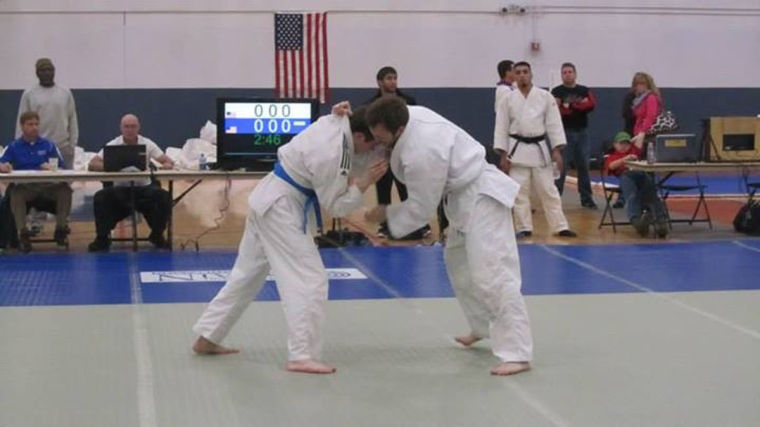 University student Michael Neal, left, competes in the Midwest Collegiate Championships on Feb. 22. Fifteen teams competed in the event, which was the first the Illini Judo Club hosted.