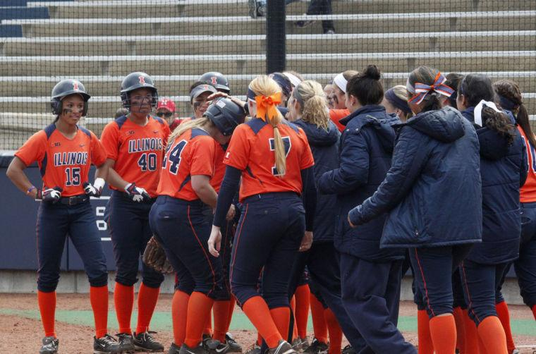 Jenna+Mychko+%2824%29+is+congratulated+by+her+teammates+after+she+hit+a+two-run+home+run+during+the+softball+game+on+Sunday%2C+April+6.+The+Illini+lost+12-3+in+5+innings.