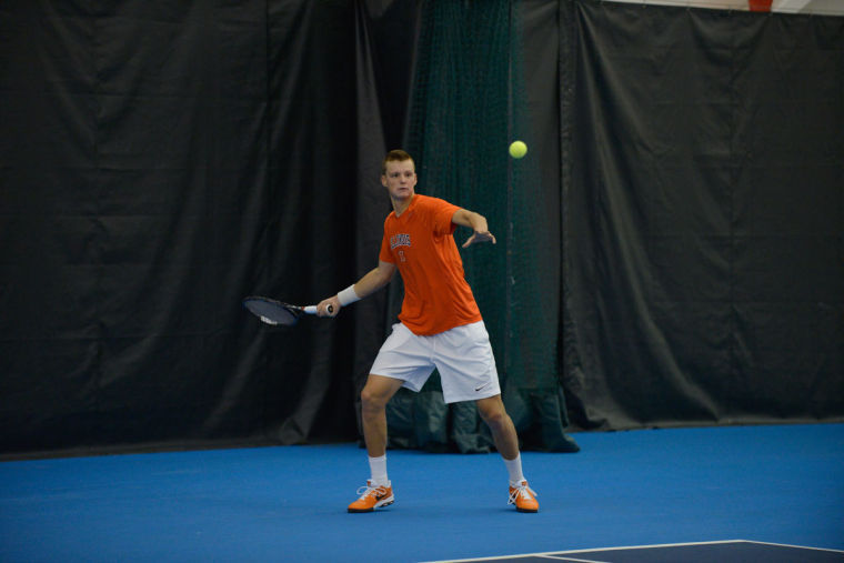 Illinois' Brian Page hits the ball during the match against No. 8 Texas at Atkins Tennis Center on Sunday, Feb. 9, 2014. The Illini won 4-3.