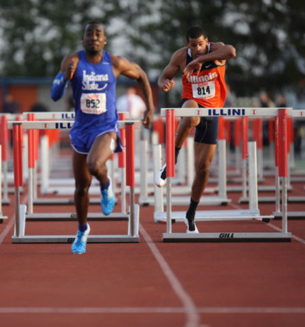 Illinois' Cam Viney goes over the final hurdle of the 110 meter hurdle event during the Illinois Twilight Track and Field meet at Illinois Soccer and Track Stadium, on April 12.