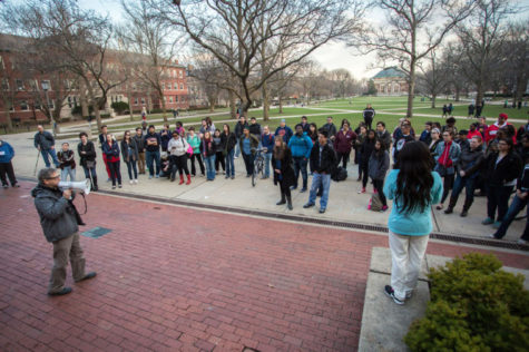 Stephen Kaufman, an MCB professor emeritus, speaks to a crowd during the Walk with Xochitl on the Main Quad on Tuesday.