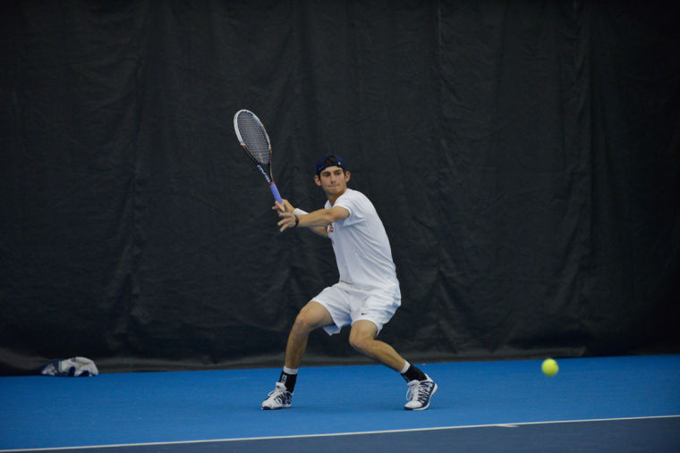 Illinois' Jared Hiltzik hits the ball during the match against No. 8 Texas at Atkins Tennis Center on Sunday, Feb. 9.