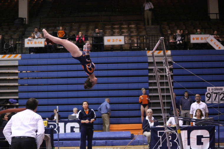 Illinois' Elizabeth McNabb performs her uneven bars routine during the meet against Michigan at Huff Hall on Feb. 7. The Illini lost 195.800-195.575.