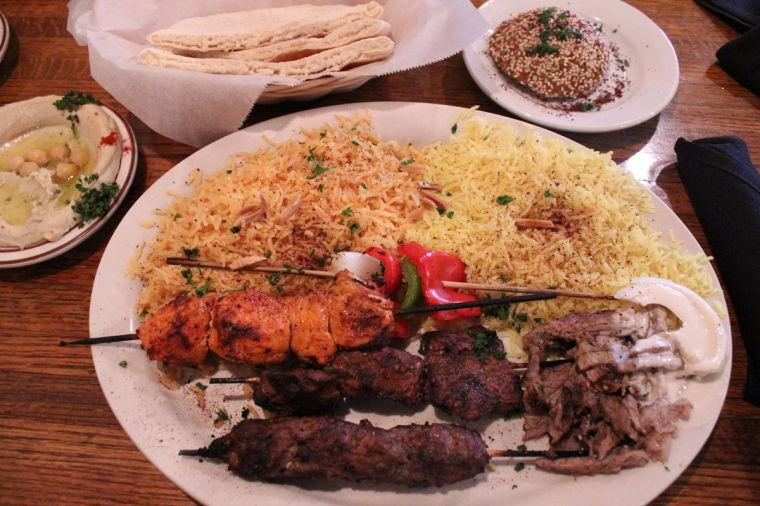The Layalina Mixed Grill from Layalina Mediterranean Grill, with hummus, pita bread, and the stuffed falafel.