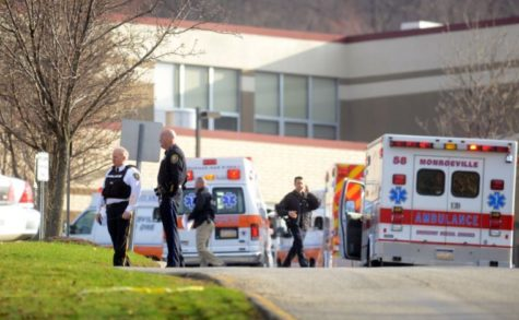 Emergency personnel are seen outside of Franklin Regional High School in Murrysville, Pa., where twenty people were injured — at least four seriously — in multiple stabbings this morning inside the high school, April 9, 2014. Most of the injured were students.