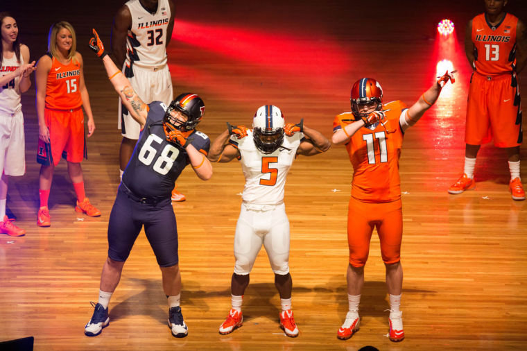 Illinois+student-athletes+Simon+Cviganovic%2C+Donovonn+Young%2C+and+Matt+LaCosse%C2%A0model+the+new+Fighting+Illini+football+uniform+during+the+Nike+Brand+Identity+Launch+at+Krannert+Center+for+the+Performing+Arts%2C+on+Wednesday%2C+April+16%2C+2014.