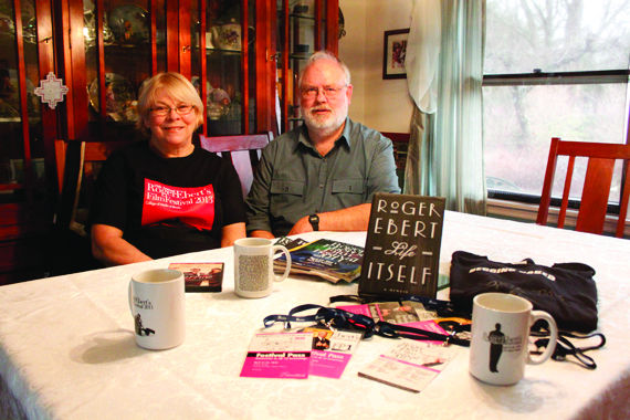 Diane and Gary Stensland of Urbana showcase their memorabilia from past Roger Ebert's Film Festivals. Together, the couple has attended 12 Ebertfests and plan on attending this year's Festival.