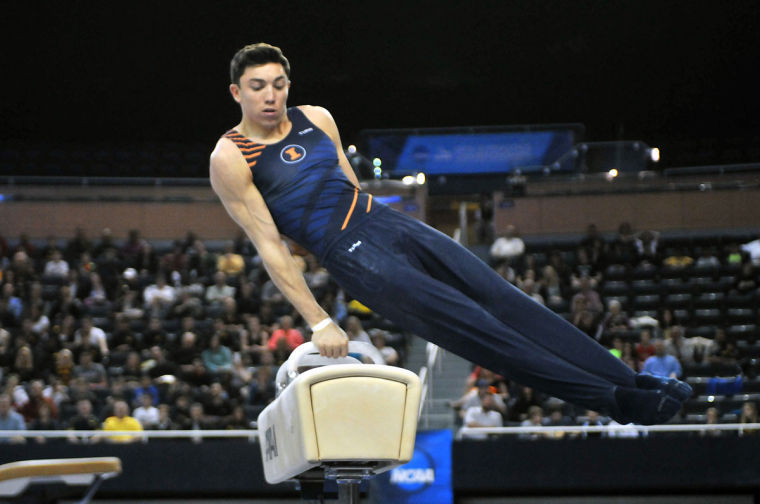 Illinois' Chad Mason performs his pommel horse routine at the NCAA national championships in Ann Arbor, Mich., on Saturday. As a team, the Illini finished fourth out of six teams.