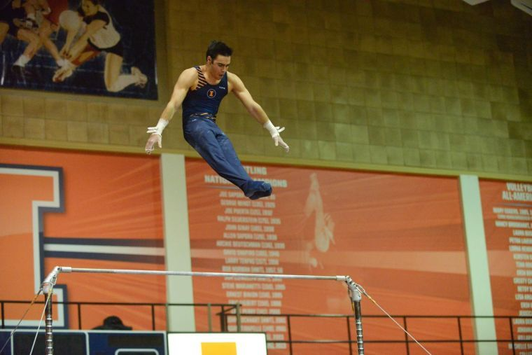 Jordan Valdez performs the high bar routine against Ohio State at Huff Hall on Sunday, Jan. 26rd, 2014.