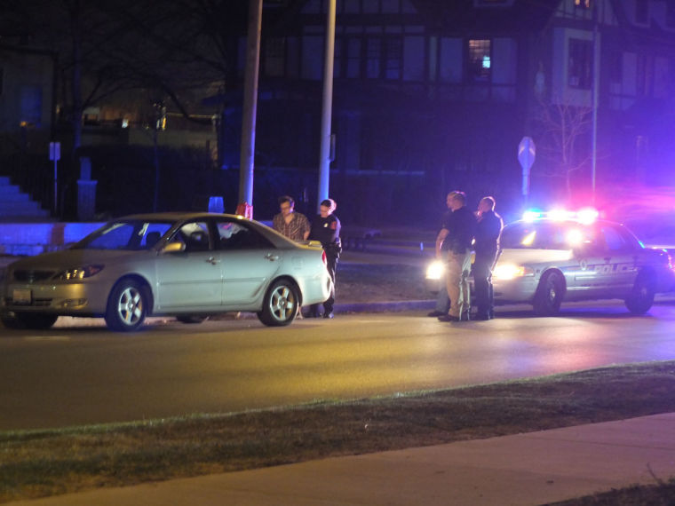 University+Police+stop+a+man+on+Green+and+Fifth+streets+who+had+an+open+alcoholic+beverage+in+the+vehicle.+Crime+has+decreased+on+campus+lately.