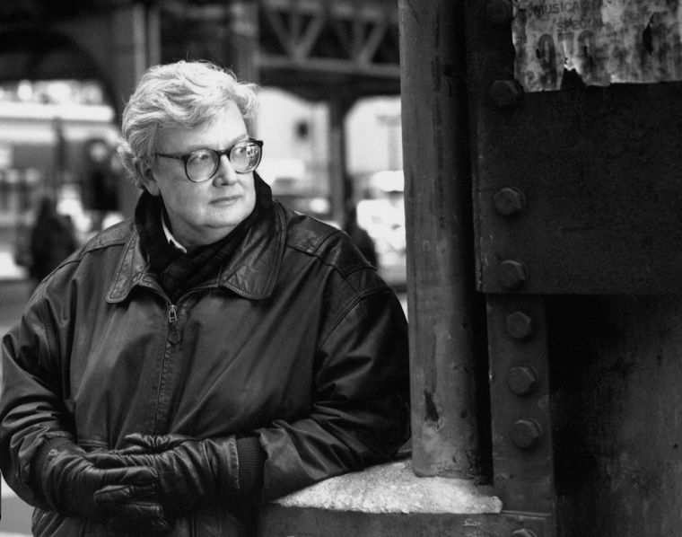 Roger Ebert looks on in downtown Chicago.