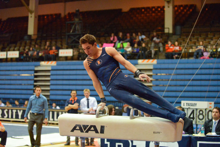 Matt Foster performs the pommel horse routine against Ohio State at Huff Hall on Jan. 26.