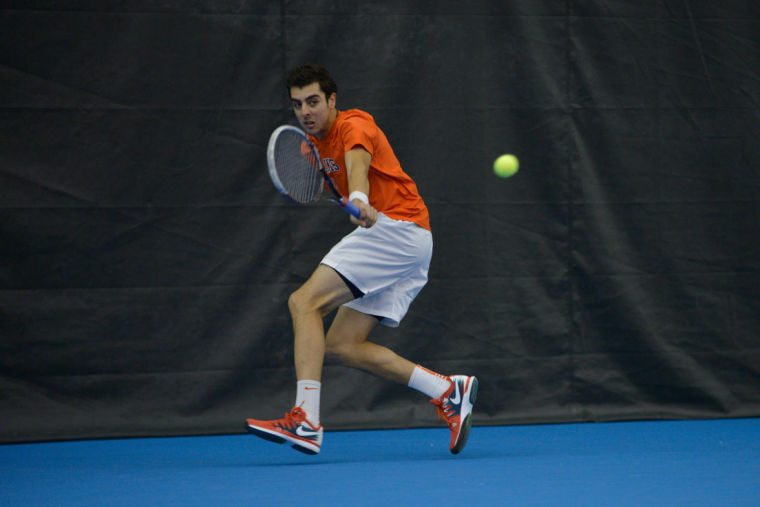 Illinois' Farris Gosea hits the ball during the match against No. 8 Texas at Atkins Tennis Center on Feb. 9, 2014. The Illini won 4-3.