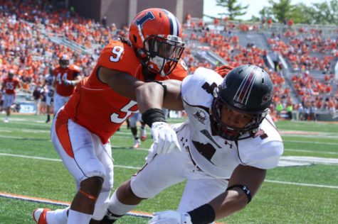 Illinois' Earnest Thomas (9) plays defense during the game against Southern Illinois at Memorial Stadium on Saturday, Aug. 31, 2013. With most starters returning, the defense looks to improve from a dreadful year.